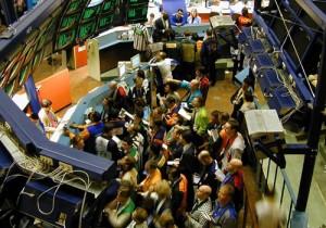 People on the floor of a stock exchange