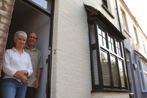 Sue Williams and John Gallop on the doorstep of their 1880s eco-home