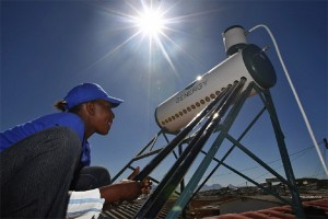 Person on roof working on a solar water heater