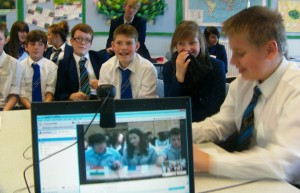 Students taking part in a virtual summit via webcam