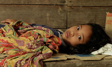 Eleven-year-old April lost her home when floods hit the Philippines in December 2012 (Source: © UNICEF/NYHQ2012-1691/Caton)