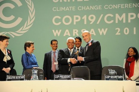 COP18 President Al Attiyah hands the ceremonial 'gavel' to COP19 chair Marcin Korolec