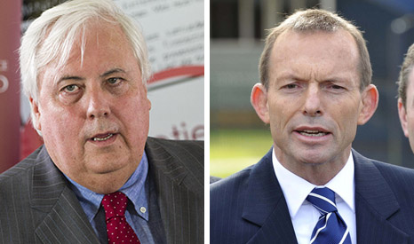 Climate sceptic MP Clive Palmer (L) wants Prime Minister Tony Abbott to scrap all his low carbon policies