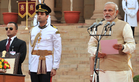 President Pranab Mukherjee (L) swears in new PM Narendra Modi (R) at Rashtrapati Bhavan, in New Delhi on May 26, 2014