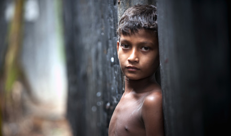 A child in Dhaka, where climate impacts are expected to further swell the city's population (UN Photo/Kibae Park)