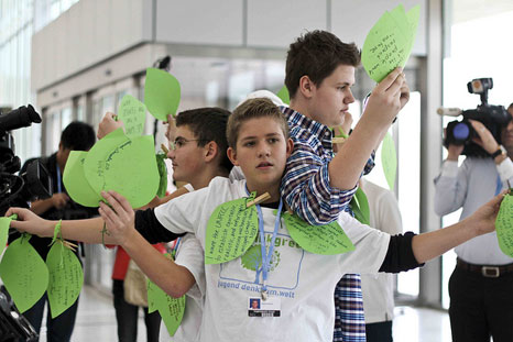 An action taking place at COP18 in Doha (Pic: theverb.org/Flickr)