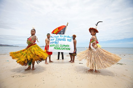 Port Moresby - activists wear traditional dress in a call to protect their islands from rising seas (Pic: Flickr/climate march/Robert Weber)