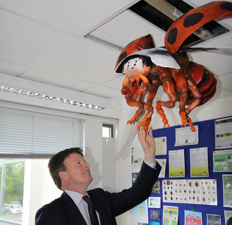 Richard Benyon meets a giant ladybird model during his time as environment minister (Pic: Flickr/CEH Science News)