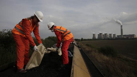Greenpeace activists occupy 1,500 tonne coal train headed for UK power station (Pic: Greenpeace)