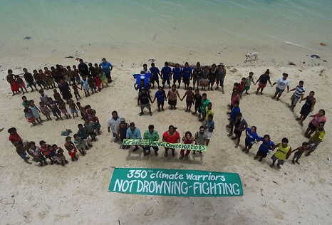 Not drowning, fighting - demonstrators on Kiribati (Pic: Flickr/Peoples Climate March)