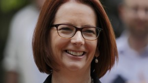 "Julia Gillard: Tony Abbott's climate policies are a ""con"""