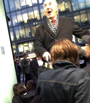 UCL president Michael Arthur scrambles over protesters to get to a meeting (Pic: Fossil Free UCL)