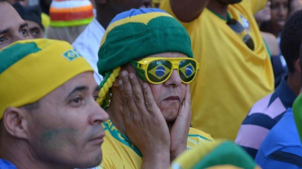 Brazilian fans watch the 2014 football World Cup (Pic: Flickr/Ben Tavener)