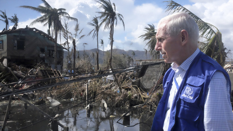 IOM Director General William Lacy Swing surveys the devastation caused by typhoon Haiyan in the city of Tacloban, Leyte in the Philippine. © IOM 2013 (Photo by Leonard Doyle)