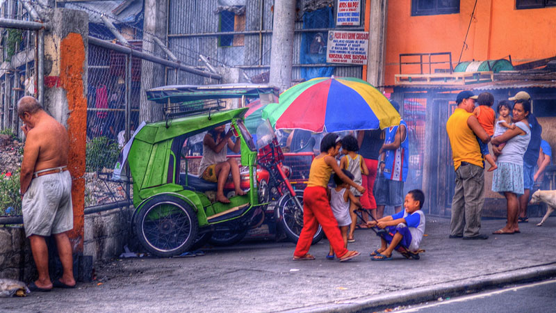 People on the streets of Manila, which has the highest population density in the world (Pic: Ville Miettinen/Flickr)