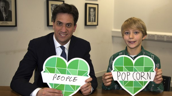 """Ed Miliband with Noah Brierley, aged 10. Noah said: """"I don't want to lose popcorn, because it is a nice food, and it is nice to have it with your friends, this would be [lost] because the weather from climate change would stop corn growing in the fields."""""""