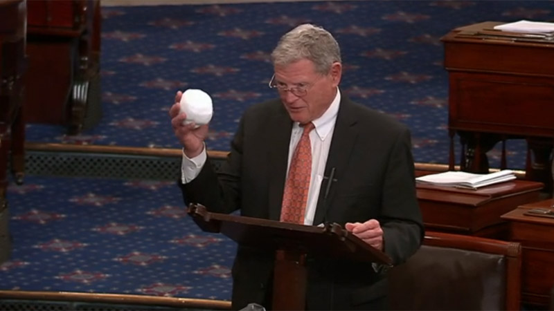 Senator James Inhofe brandishing a snowball in Congress as a challenge to scientific evidence on global warming