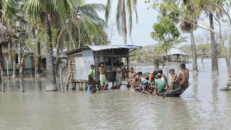 After floods in Bangladesh, local people are taught to reach the shops by boat (Pic: Department for International Development/Rafiqur Rahman Raqu)