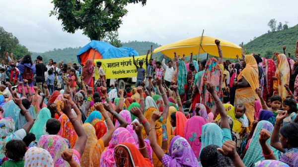 Tribal women from villages adjacent to Mahan forests in central India raise slogan against coal mining and displacement during Rakshabandhan festival. (Pic: Avik Roy)