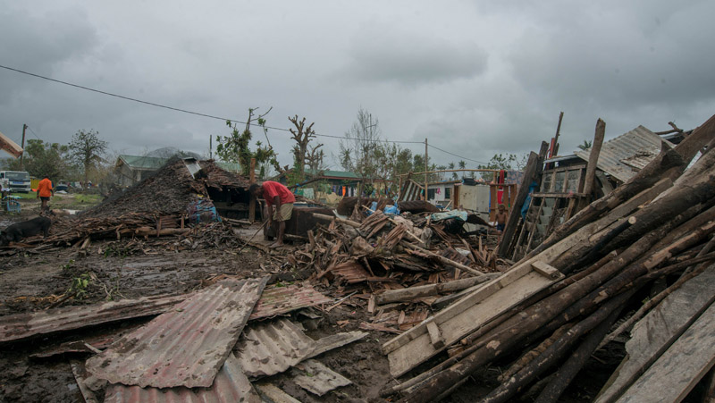 Vanuatu islanders survey the damage wreaked by Cyclone Pam (Pic: Unicef Pacific)