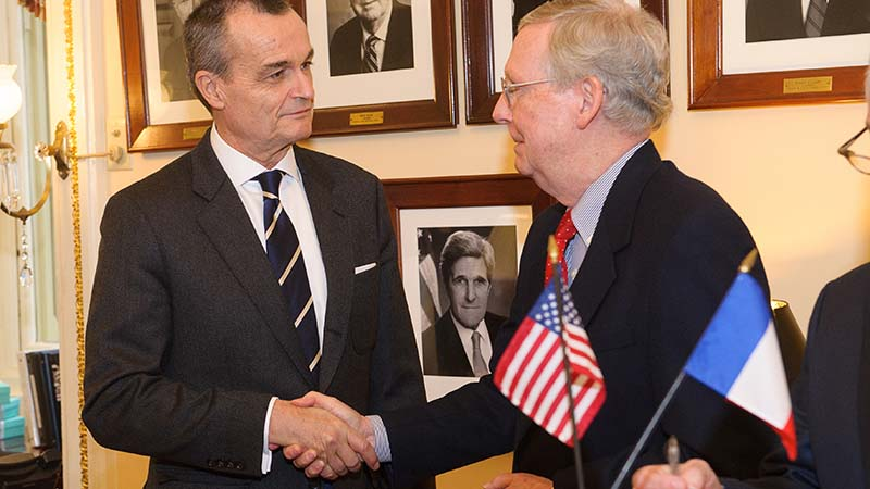 Republican Senate Leader Mitch McConnell (right) with French envoy to the US (Flickr/ French Embassy in the US)