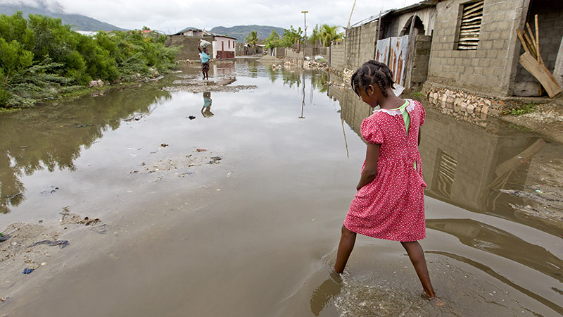 A girl walks throught the flooded streets of her neighbourhood in Haiti's northern city of Cap Haitian (Pic: UN Photos)