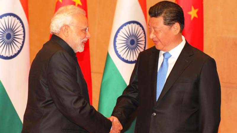 Narendra Modi and Xi Jinping shake hands at the meet on May 14 (Twitter/ Narendra Modi)