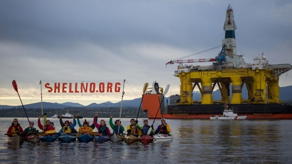 Activists paddle up to Shell's Polar Pioneer rig in Seattle, to protest Arctic drilling (Flickr/sHell No! Action Council/Charles Conatzer)