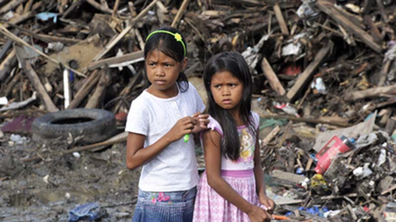 SG Visits the Philippines, Assesses UN Relief Efforts Secretary-General Ban Ki-moon visited Tacloban City, in the Leyte Province of the Philippines, to assess the relief and rehabilitation efforts for the survivors of Super Typhoon Yolanda/Haiyan. Two girls from Tacloban stand in front of some of the damage and debris left by a Typhoon Haiyan in 2013 the storm. (UN photos)