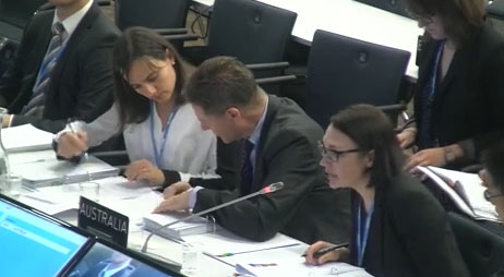 Ambassador Peter Woolcott discusses responses with colleagues at today's UN session in Bonn