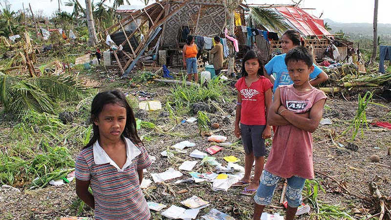 School children in the Philippines contemplate the aftermath of Typhoon Haiyan in 2013 (Pic: Pio Arce/Genesis Photos)