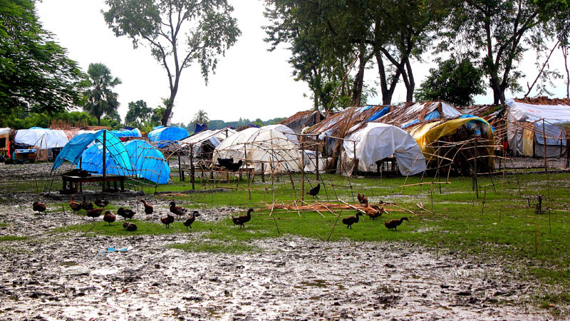 Makeshift tents positioned precariously on the sodden ground as the awaits cyclone relief in 2011 (Credit: Transparency International/ Alice Harrisson)