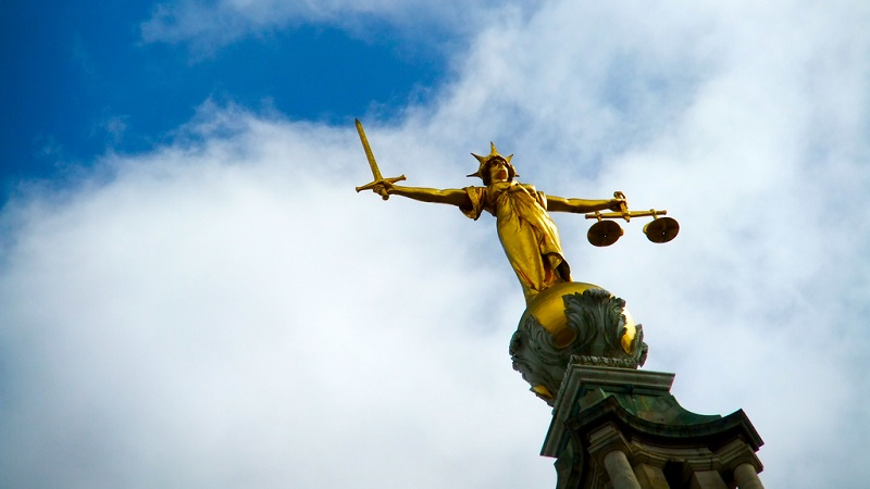 The scales of justice are weighing the evidence for climate action (Flickr/James Cridland)