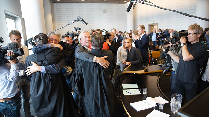 Climate campaigners cheered and hugged each other as the verdict was read out at a district court in the Hague on June 24 (Photo: Urgenda)