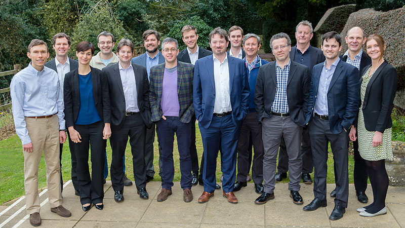 The Carbon Tracker Initiative team with Campanale (checked jacket) and Hobley (blue suit) at the centre (Pic: Darren Charles Holloway)