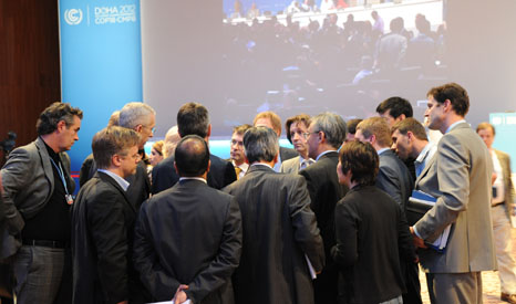 Negotiators huddle on the floor at 2012's Conference of the Parties in Doha (Pic: UNFCCC)
