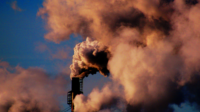 Pollution spews out of a Canadian paper mill. The planet has warmed 0.85C since the Industrial Revolution (Flickr/ Billy Wilson)