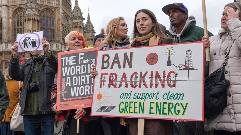 Protestors opposing fracking gathered outside  the UK's Parliament, on the day lawmakers discussed new proposals (Pic: Flickr/RonF)