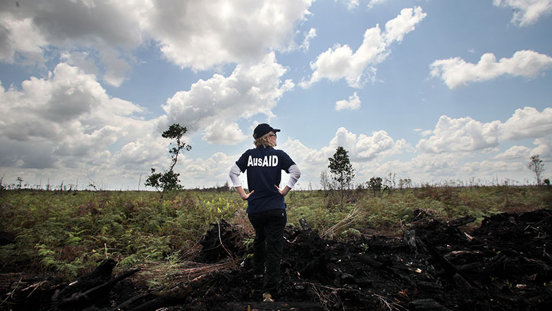An AusAID officer inspects a vast area of cleared land destroyed by fire and farming in Central Kalimantan, Indonesia. Australia has committed $30 million to helping Indonesia address climate change and forest degradation. Photo: Josh Estey for AusAID. To request copyright use and access to hi-res versions of this photo, contact photolibrary@ausaid.gov.au