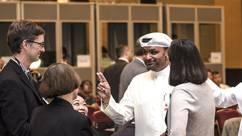 Delegates from Kuwait and US chatting before the opening of the morning plenary (credit: ISSD)