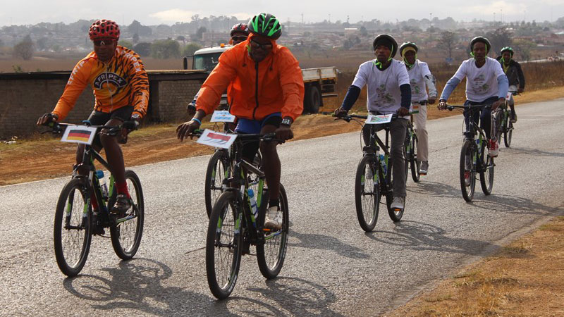 Cyclists are moving in groups of 21 in a reference to the UN's 21st annual climate meeting known as COP21