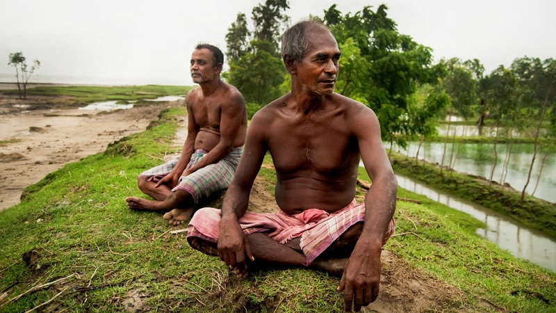 Childhood friends Das and Dolui say climate in Ghoramara is getting worse with each passing year