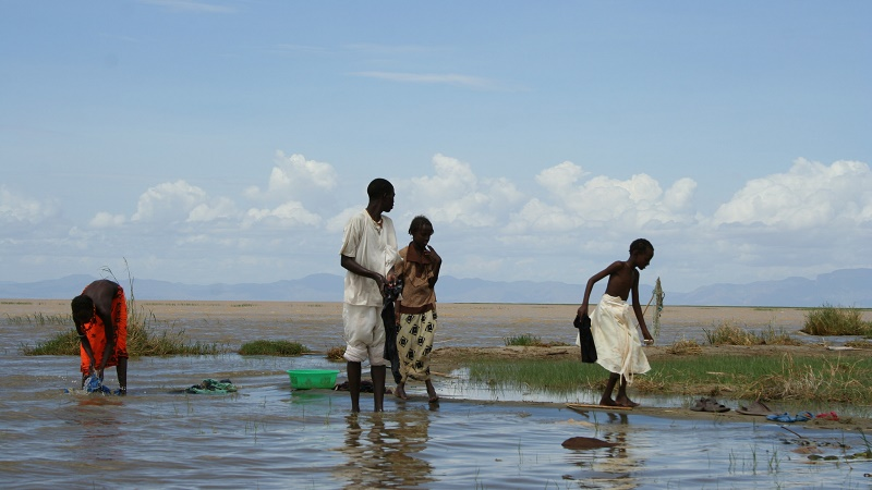 People wash clothes in Lake Turkana. A 300MW windfarm is planned nearby (Flickr/International Rivers)