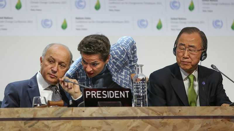 UN climate chief Christiana Figueres leans in to speak to COP president Laurent Fabius (Photo by IISD/Kiara Worth)