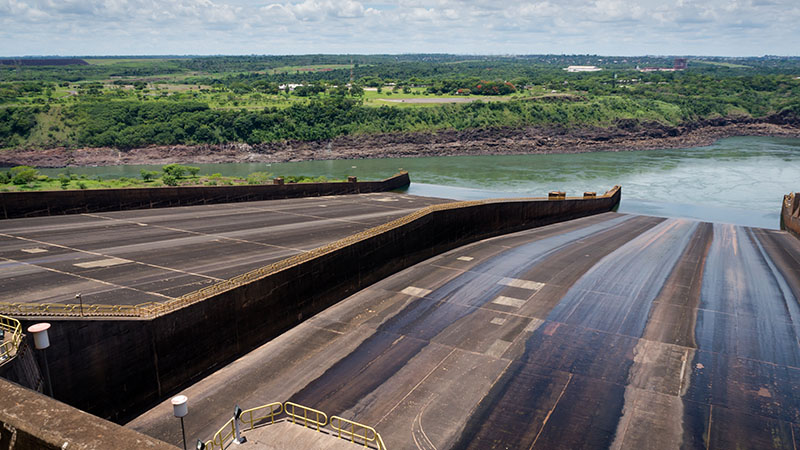 The gigantic Itaipu Dam, which lies on the Brazil-Paraguay border, faces erratic rainfall shifting climate (Flickr/ Deni Williams)