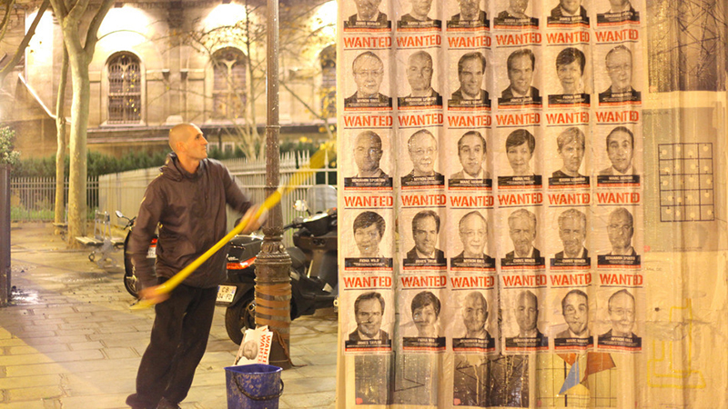 Posters of 'climate criminals' made by campaign group Avaaz before a Heartland Institute in Paris in December (credit: Avaaz)