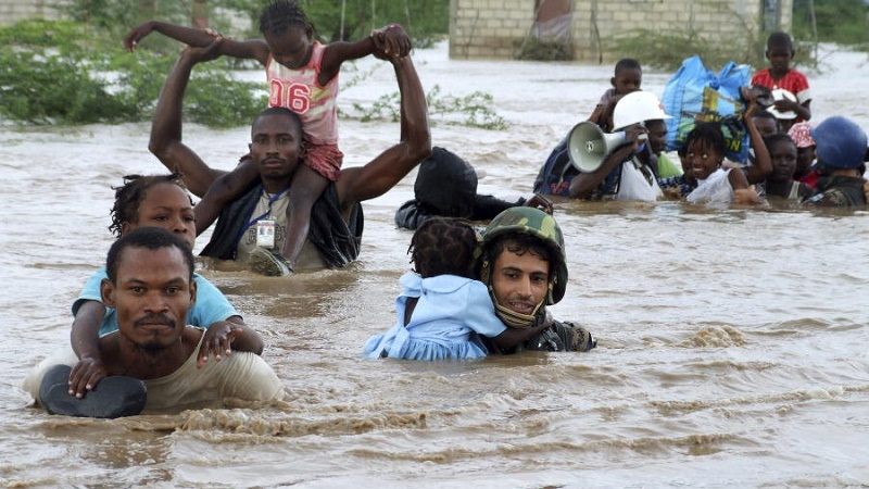Children being rescued from floodwaters in the aftermath of Hurricane Ike, Haiti 2008 (UN Photo/Marco Dormino)