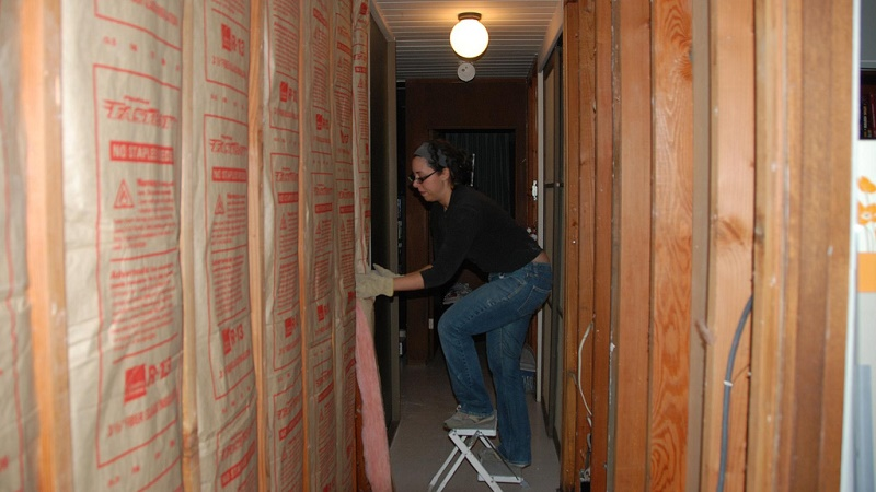 It's not flashy, but it's authentic - installing insulation (Flickr/Nick Nguyen)