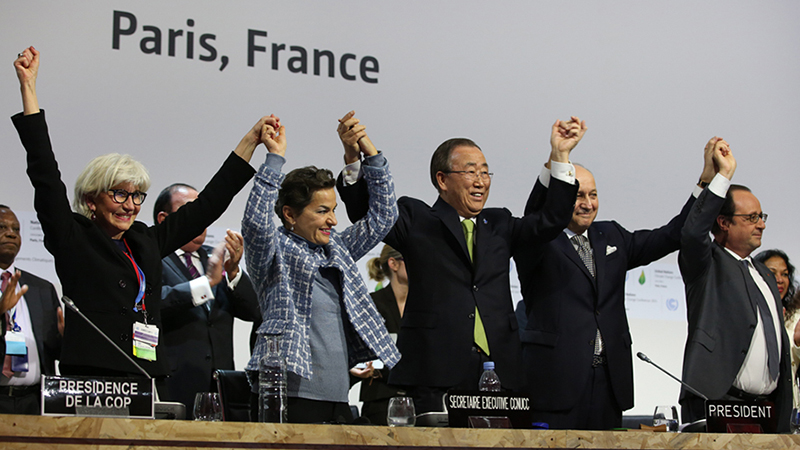 Laurence Tubiana, COP 21/CMP 11 Presidency; UNFCCC Executive Secretary Christiana Figueres; UN Secretary-General Ban Ki-moon; COP 21/CMP 11 President Laurent Fabius, Foreign Minister, France; and President François Hollande, France, celebrate the adoption of the Paris Agreement (credit: IISD.ca/Kiara Worth)