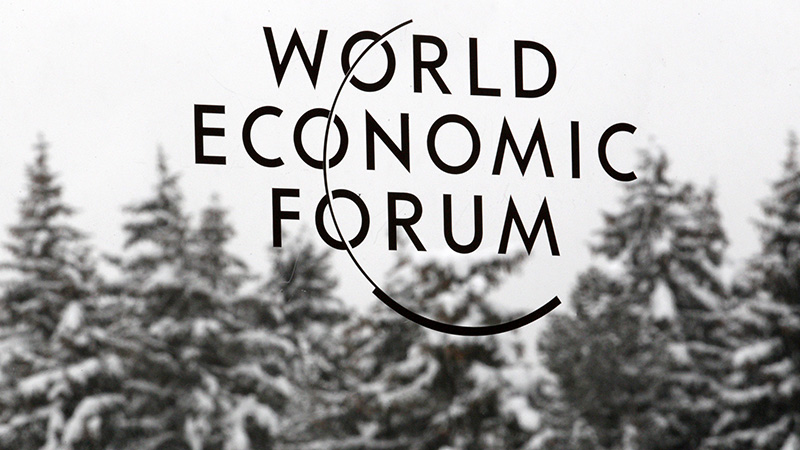 A logo of the World Economic Forum (WEF) is seen stuck on a window at the congress center in the Swiss mountain resort of Davos January 23, 2012. The upcoming WEF will be held from January 25 to 29. REUTERS/Christian Hartmann (SWITZERLAND - Tags: POLITICS BUSINESS) - RTR2WQJ1